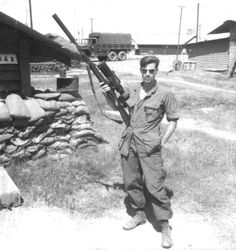 Legendary Marine Corps. Sniper Sgt Carlos Hathcock, Vietnam, 1968. OMG look at the size of that thing!!!