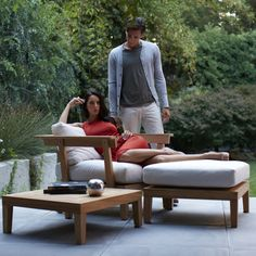 Gloster Solo Lounge Chair: Modern teak frame with plush cushions
