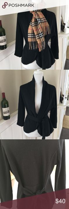Bcbg Maxazria wrap cardigan BCBG Maxazria wrap Cardigan Black size Medium. This cardigan you can get two looks with. Wrap at the waist in front or war against the cardigan in the back. So on trend Cardigan. BCBGMaxAzria Sweaters Cardigans
