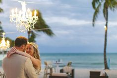 Beach wedding in Key West with chandeliers and a dance floor, photo by cptphotography.com