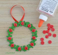 Transform old puzzle pieces and buttons into a lovely kid make wreath ornament for the Christmas tree.
