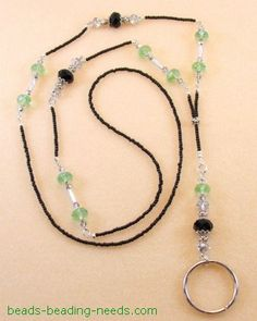 This free beaded lanyard pattern is a stunning Peridot and Black Crystal jewelry piece. Learn how to make a lanyard with these basic jewelry making instructions.