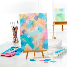 Create a beautiful work of art using watercolors and tissue paper.