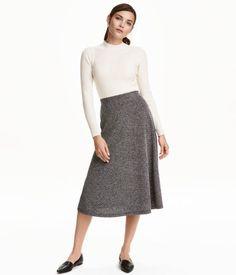 Black/white melange. Flared, calf-length skirt in textured-weave, viscose-blend…