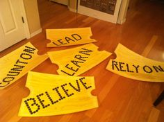 """Giant Polar Express tickets for party decor. Created by painting foam board gold, cutting notches from each end to shape. Used 1/2"""" punch to punch out card stock dots to spell out the words."""
