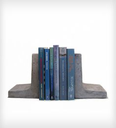 Modern and simple in shape, classic concrete texture, these are solid, heavy pieces that will keep your books in place. The piece is covered with natural looking clear sealer. Felt pads are attached.