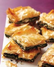 Crisp phyllo tops a fresh-tasting spinach-and-feta filling in this savory Greek pie. Cut into small squares and served at room temperature, this pie makes a terrific hors d'oeuvre.