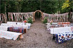The idea of putting colorful quilts on the benches at the ceremony is such a great idea! | Wedding Chicks