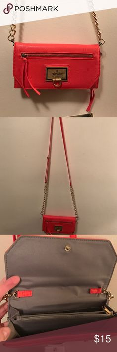 """Crossbody Wallet Purse Coral colored. Crossbody (strap can be adjusted), wallet style purse. Perfect for traveling! The top opens to a wallet compartment. Small zipper pocket on back. 8"""" by 4.5"""". Great condition - only used a few times! Nicole by Nicole Miller Bags Crossbody Bags"""
