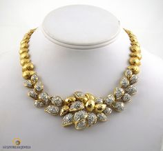 Over 12cts of round brilliant cut diamonds set in a uniquely textured 18kt yellow gold necklace, available at Gulfstream Jewels