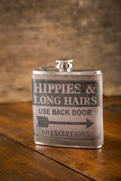 Yeah, this one might be our favorite.  New Hippies & Long Hairs Hip Flask on BourbonandBoots.com