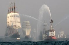 Vessels sail during a great parade of the Culture Tall Ships Regatta on the Bay of Gdansk near the eastern Polish Baltic Sea city of Gdynia.