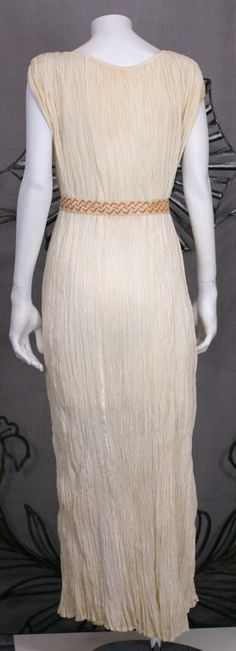 This extraordinarily rare dress is made of finely pleated white cotton. Few cotton pleated Fortuny dresses have been documented and survived.