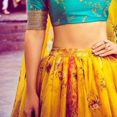 the mood kept light with a beautiful yellow lehenga and turquoise blouse contrasting the former Lehenga Designs, Indian Wedding Outfits, Indian Outfits, Indian Clothes, Desi Clothes, Hot Topic Clothes, Clothes For Women, Sabyasachi Collection, Yellow Lehenga