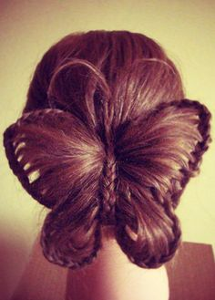 Butterfly updo! This. Is awesome but it looks like it would be a pain in the @$$ to get that perfect!