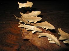 schools of fish carved from butternut wood