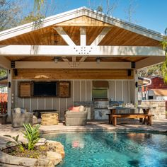 Make living poolside your lifestyle with this outdoor kitchen and seating area covered with a custom cabana #PrattGuys #enjoyearth #outdoorspaces #outdoordesign #dreambackyard #backyarddesign #backyardinspo #pools #pooldesign #cabana #poolside #tropical