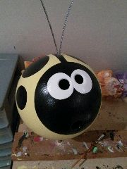 yellow ladybug bowling ball