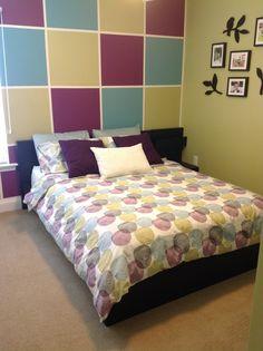 Green, purple, turquoise guest bedroom.