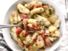 German Potato Salad is tossed in a deliciously sweet and tangy mayo-free dressing with bacon, mustard, and vinegar. Perfect for potlucks! Bacon Recipes, Pasta Recipes, Warm German Potato Salad Recipe, Crab Pasta Salad, German Potatoes, Sliced Potatoes, International Recipes, Food Network Recipes, Main Dishes