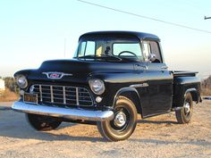Black 1955 Chevrolet Truck. My dad had one just like this and added twin pipes..in its day it was a beauty..and fast. Got my first and only citation for revving the engine.  Loved the sound of the pipes!