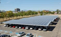 New solar carports cover 600 parking spaces at the Denver Federal Center. In a couple years when we all drive our Teslas to work we'll charge up right here (unless its cloudy).