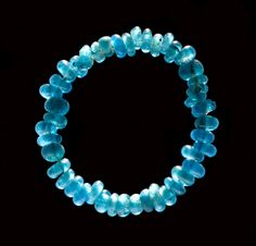 These small blue glass beads from Kongehøj at Humlum originate from the Mediterranean area or southeast Europe. The exotic beads sat on the arm of a rich woman, who was buried in a mound in the Early Bronze Age. Fashion, jewelry, money, value, Prehistoric Period,