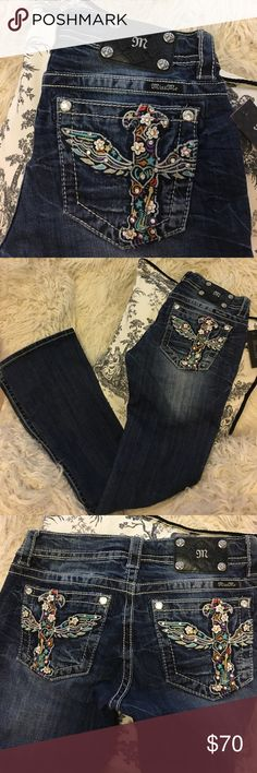 """NWT Miss Me Jeans 28 x 34 Signature Boot, 34 inseam, brand new with tag! Really cute guitar and love flower cross design on the back pockets -8"""" rise. 15"""" across the waist laying flat. I'm measuring a 33 1/2"""" inseam. Perfect condition, non-smoking home, I just have too many pairs of jeans! Miss Me Jeans Boot Cut"""