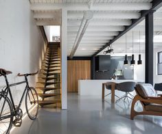Built by Atelier Moderno in Montreal, Canada with date 2014. Images by Stéphane Groleau. A designer, his two sons, and their tireless terrier Winston share a small 1950's building that stands rather unnotic...