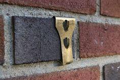How to Hang Art on Brick or Stone >> http://blog.diynetwork.com/maderemade/2015/10/27/how-to-hang-art-on-brick-stone/?soc=pinterest