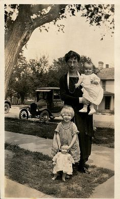Great vintage photo of a mother and her two children, with one little girl posing with her prized dolly - (by depthandtime, via Flickr)