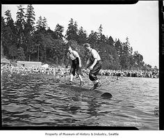 Two men in log rolling contest at Seward Park, Seattle, August 1938