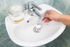 How To Clean Bathroom Sink Drain How To Unclog A Drain Without Calling A Plumber with ucwords] Unclog Bathroom Sinks, Under Bathroom Sinks, Bathroom Ideas, Clogged Sink Drain, Homemade Drain Cleaner, Baking Soda Uses, Natural Cleaners, Tricks, Cleaning Hacks