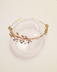 Riley: Whimsical gold branch headband with pearls. $165.00, via Etsy.