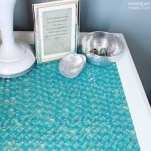 Glass Gem Tiled Table..So cute and easy..I see designs, all kinds of really sweet stuff, all with a little paint, glue,and dollar store gems..See the complete how to over at http://www.madiganmade.com or hometalk..