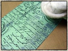 Tim Holtz shows how to create a resist using black Distress Paint, Distress embossing ink and rubber stamps.