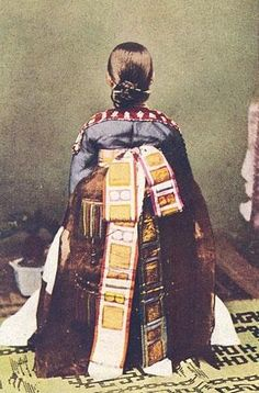 Old photograph c. 1900 of the back of a wedding Hanbok. She's sitting on the chinese hanzi  of double happiness. #PhotojournalismKorea
