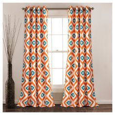 These room darkening curtains will instantly make a statement in any room of your home. Regal elephants stand proudly with decorative dress in bright colors creating a bohemian style look. Part of the Hati Elephants Collection.