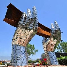 ~<3~ Rosemead, CA - The sculpture consists of an iron beam pulled from the rubble of the World Trade Center held up by two stainless steel hands. The hands holding it up are constructed from 2,976 individually crafted stainless steel doves - each representing a victim of the attacks.