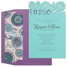 The top of this delectable robin's egg blue invitation is die-cut into a cute floral pattern.