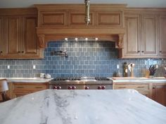 Backsplash in grey with a hint of blue, but maybe it needs a bit more interesting pattern.