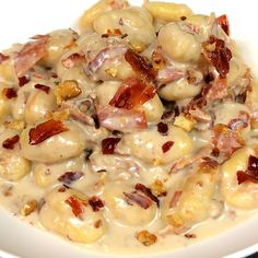 """This is """"Gnocchi con crema di gorgonzola, speck e noci"""" by Al.ta Cucina on Vimeo, the home for high quality videos and the people who love them. Tasty Videos, Food Videos, Easy Healthy Recipes, Easy Meals, Cucumber Recipes, Comfort Food, Italian Recipes, Chicken Recipes, Dinner Recipes"""