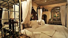 Mariposa Mexico: If you don't mind sleeping under the eye of Jesus, the master bedroom has a holy appeal.  Capture the spirit of Mexico with Religious Folk Art from http://www.lafuente.com/Mexican-Art/Religious-Folk-Art/  #Mexico #interiordesign #decor