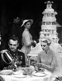 Prince Rainier III and Grace Kelly  After their afternoon nuptials on April 19, 1956, guests lunched al fresco and finished their meal with a traditional cake adorned with cherubs.