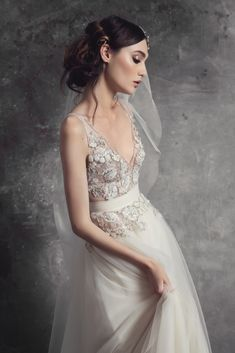 Tulle bodice with beaded edges and French lace decorated with seed beads and petals. Soft Italian tulle skirt.
