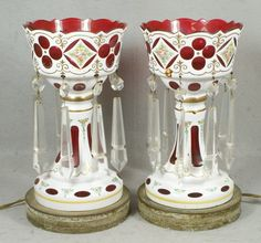 White cut to cranberry cased glass lusters with inverted spear shaped prisms
