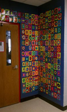 Totally doing this in the future for my art classroom!! Kandinsky-inspired wall art.