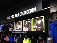 Nike Bra Bar women's sportswear frames and retail display.