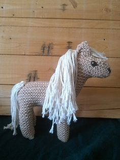 How to knit a simple horse toy softie - Jeannie R. Lee provided quick instructions for a simple horse toy with basically two pieces, modified from the pattern in A First Book of Knitting for Children by Bonnie Gosse and Jill Allerton. Pictured project is by crunchymamakim
