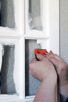When painting glass panes, don't bother taping first, just paint, let it dry, spray with a vinegar/water solution, score along the edge of the pane and scrape off with a razor blade scraper and the paint comes off easily